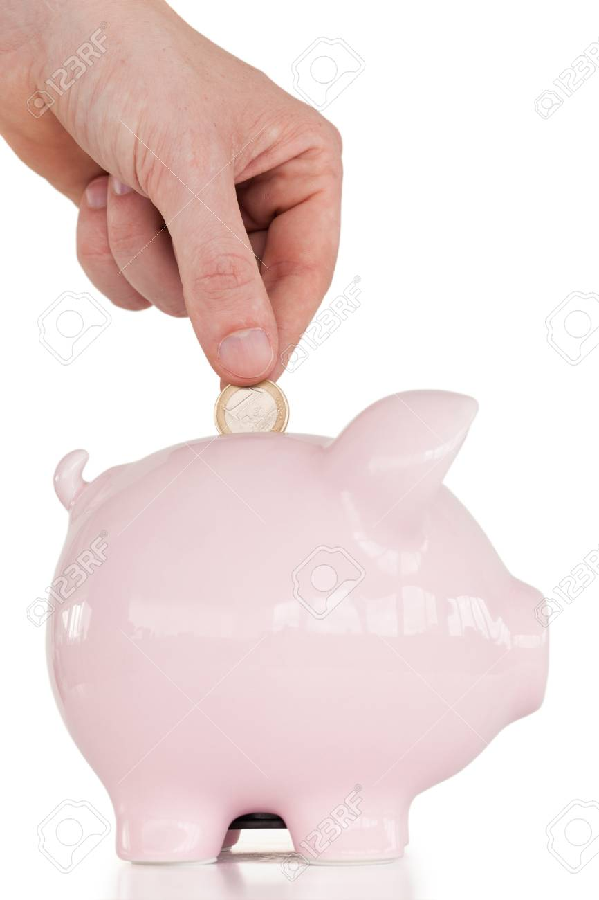 Hand inserting a coin in a pink piggy bank against a white background. Stock Photo - 10069786