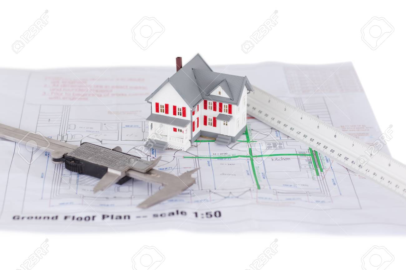 Toy house model and ruler and on a plan against a white background Stock Photo - 10069963