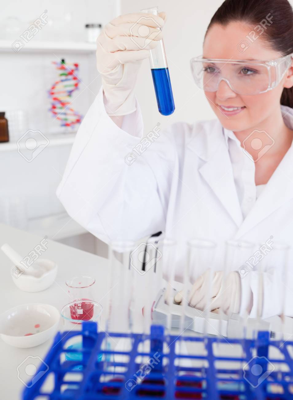 Attractive red-haired woman holding a test tube in a lab Stock Photo - 10070775
