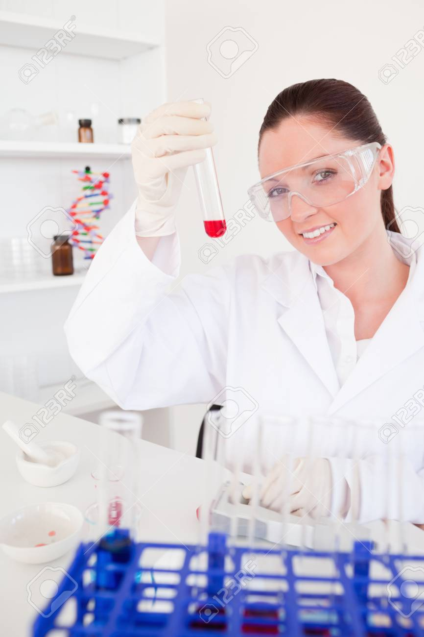 Charming red-haired woman holding a test tube in a lab Stock Photo - 10070798