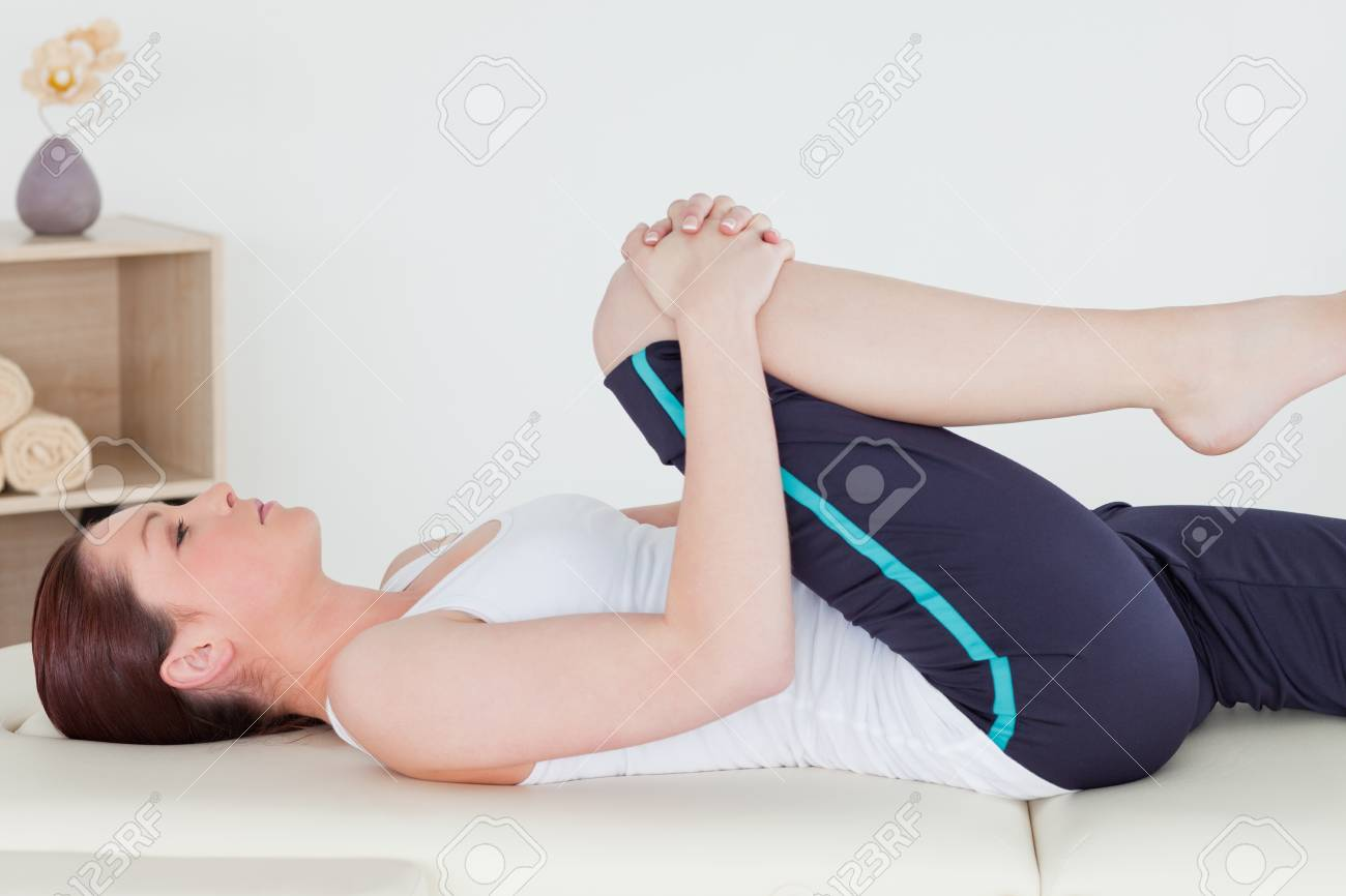 Sportswoman stretching her leg Stock Photo - 10071842