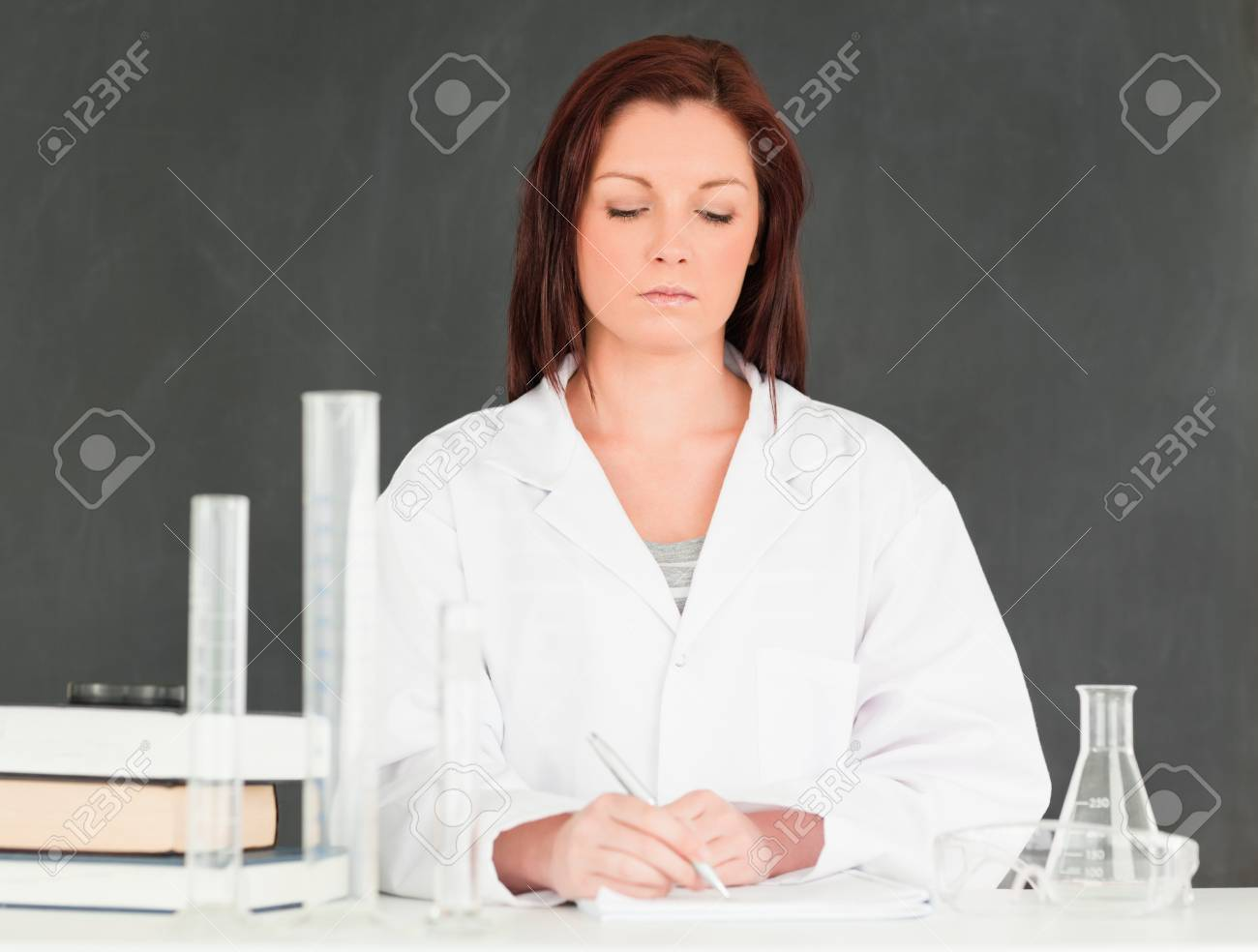 Serious scientist taking notes in a classroom Stock Photo - 10071849