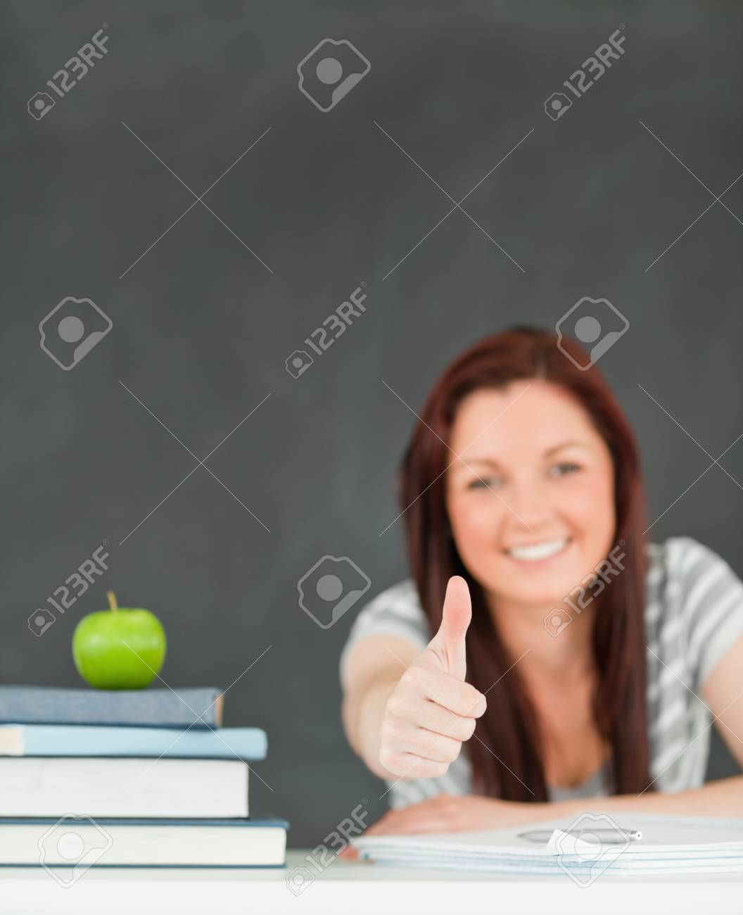 Cheerful young student in a classroom Stock Photo - 10074364