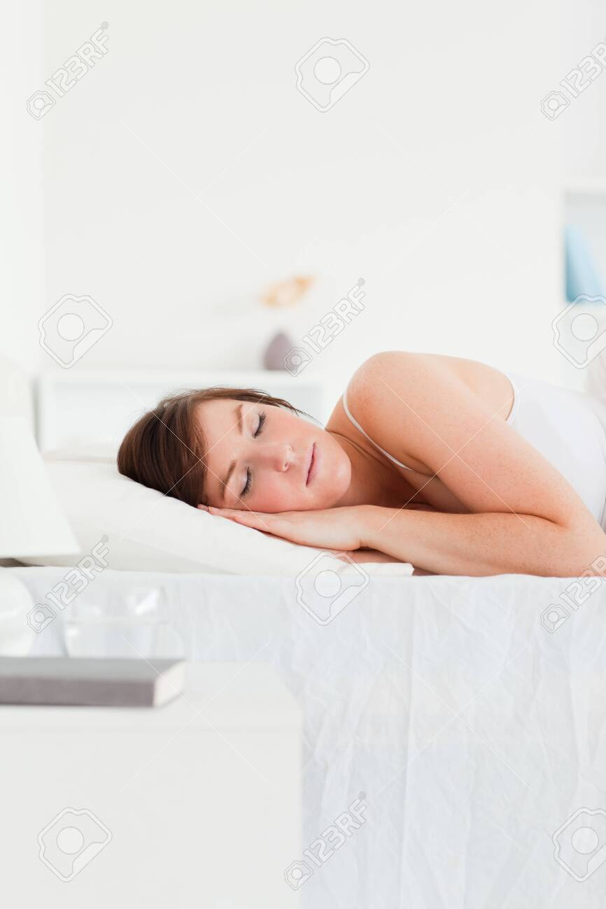 Gorgeous brunette female having a rest while lying on a bed Stock Photo - 10070207