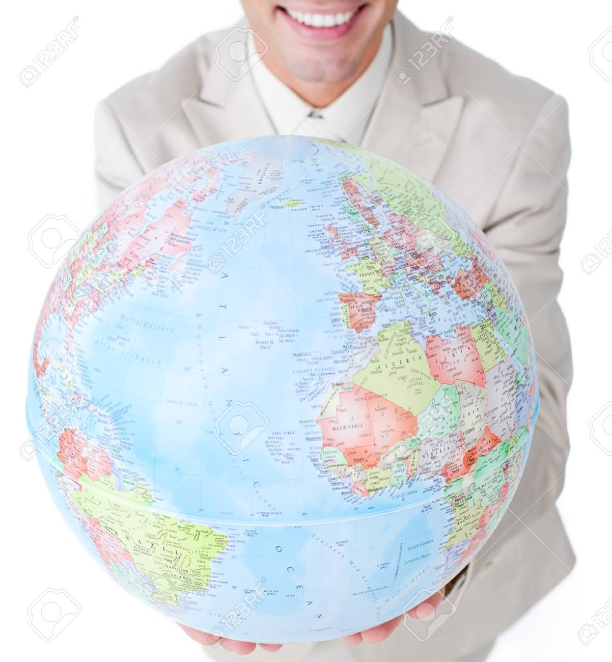 Smiling businessman holding a globe Stock Photo - 10075317