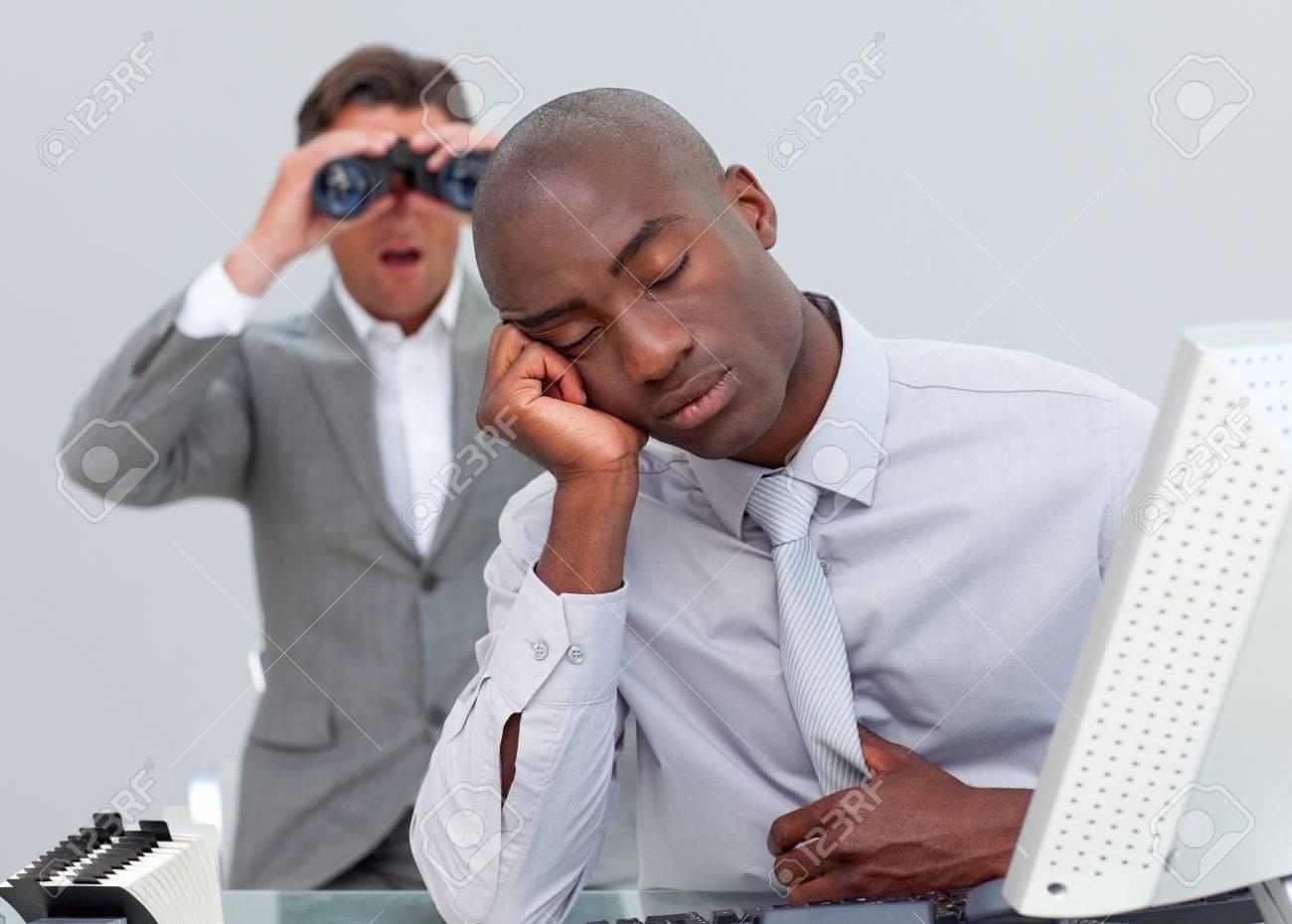 Ethnic businessman annoyed by a man looking through binoculars Stock Photo - 10091180