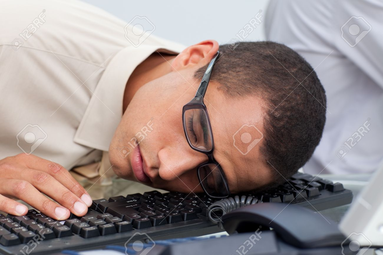 Young Businessman Sleeping On The Keyboard Stock Photo, Picture And Royalty Free Image. Image 10094201.