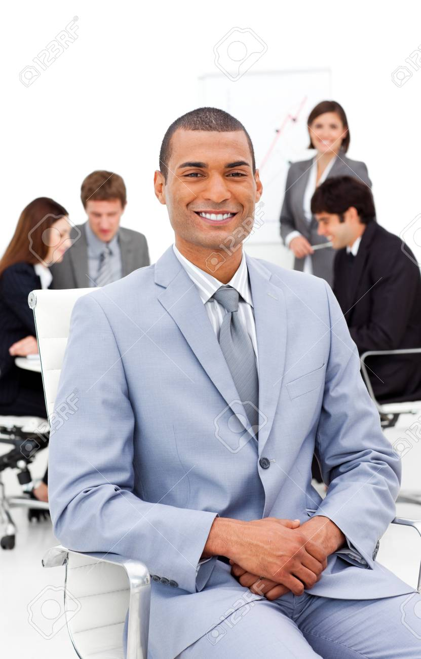 Afro-american businessman sitting in front of his colleagues Stock Photo - 10095317