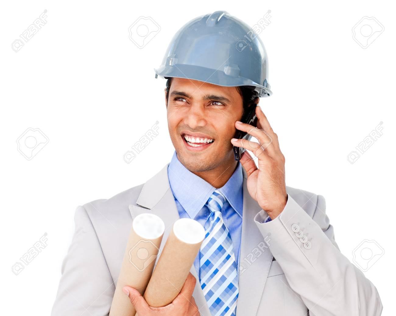 Confident architect on phone carrying blueprints Stock Photo - 10092854