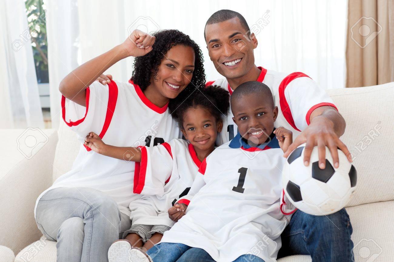 Afro-American family celebrating a football goal Stock Photo - 10112110