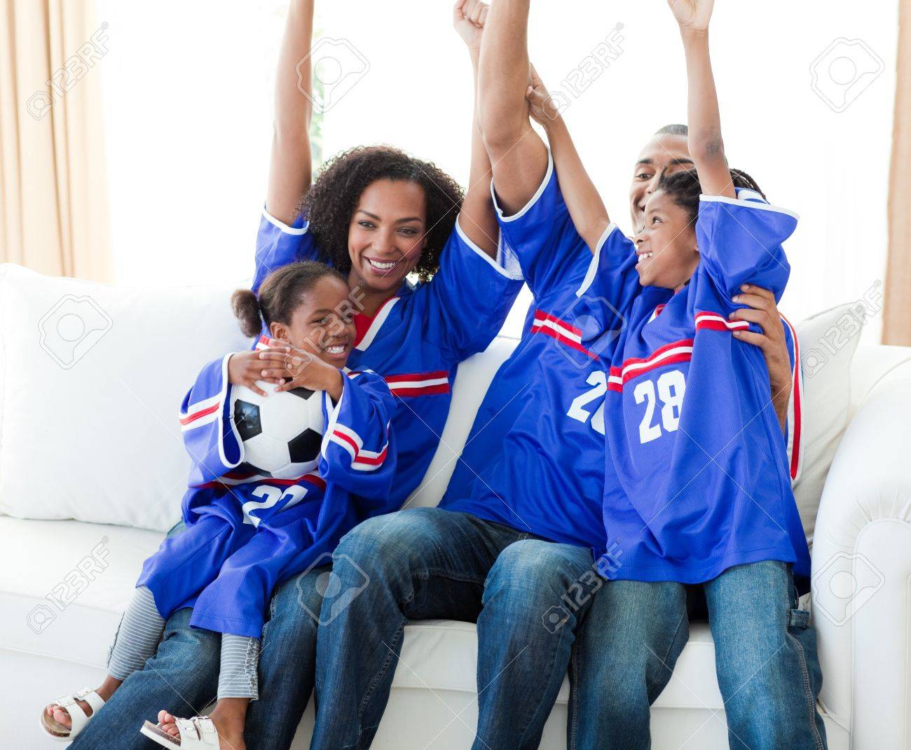 Excited Afro-American family celebrating a football goal Stock Photo - 10108254