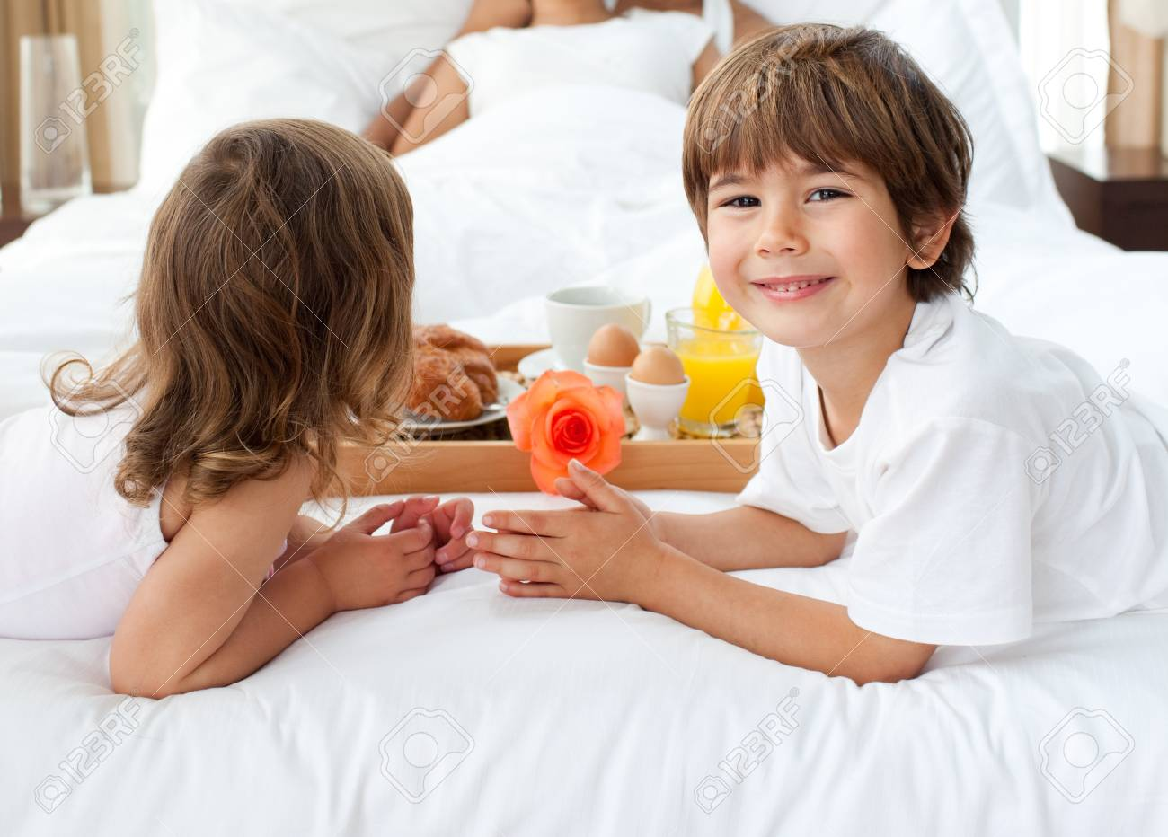 Close-up of siblings bringing breakfast to their parents Stock Photo - 10092882