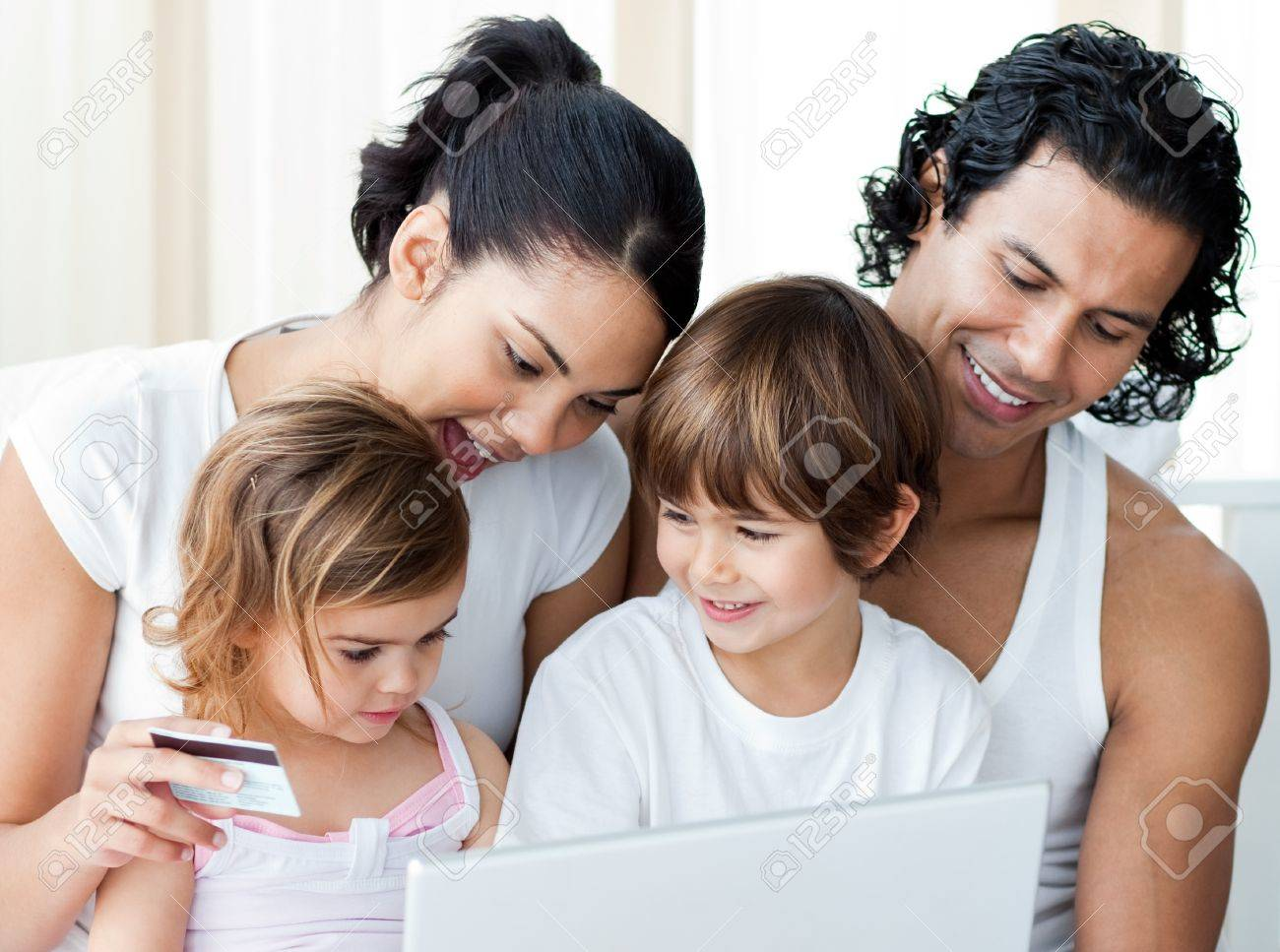 Close-up of a family shopping online Stock Photo - 10091517