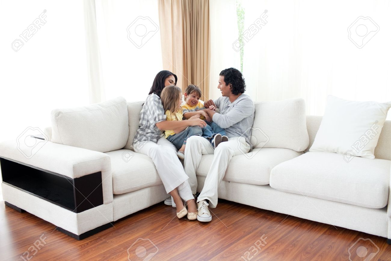 Wonderful Animated Family Having Fun Sitting On Sofa Stock Photo   10108259