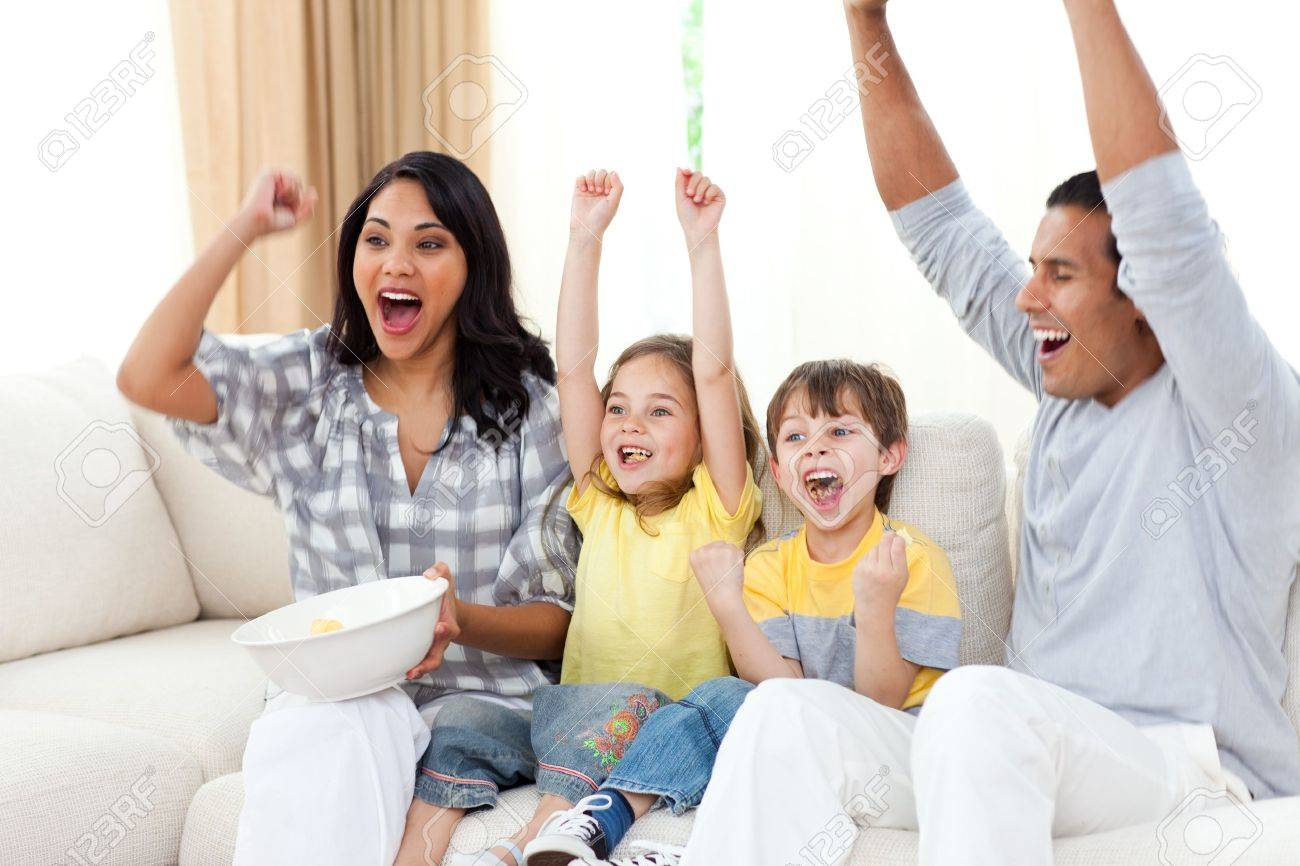 Animated family watching TV on sofa - 10095219