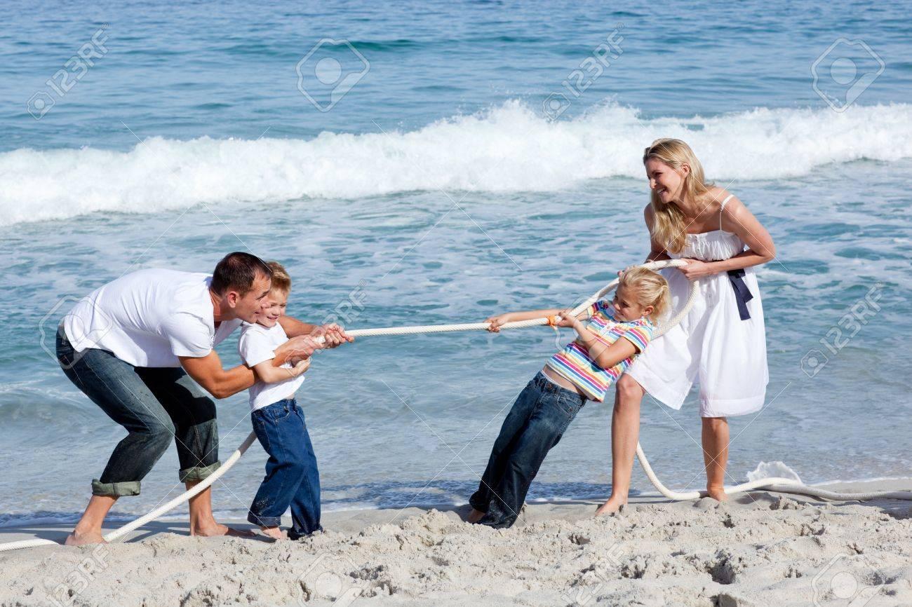 Cheerful family playing tug of war Stock Photo - 10109099