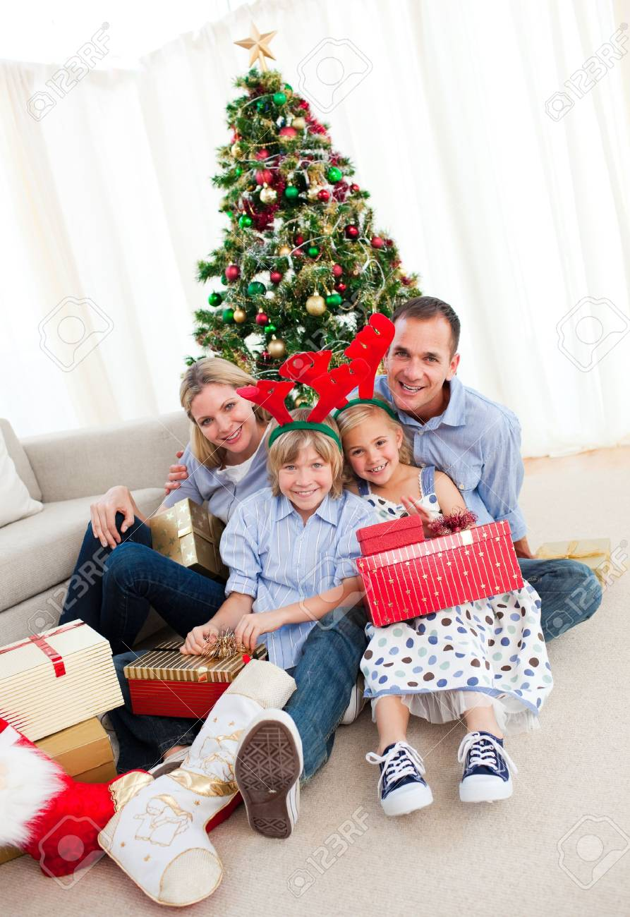 Portrait of a smiling family holding Christmas presents Stock Photo - 10108432