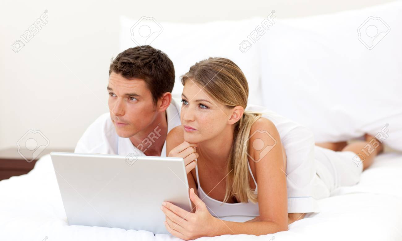 Intimate couple using a laptop Stock Photo - 10071951