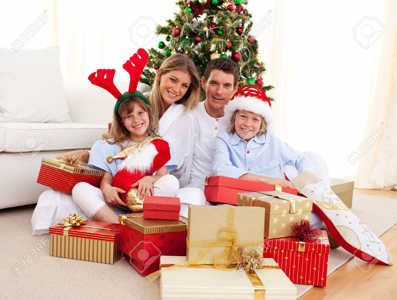 Happy family holding Christmas gifts Stock Photo - 10107617