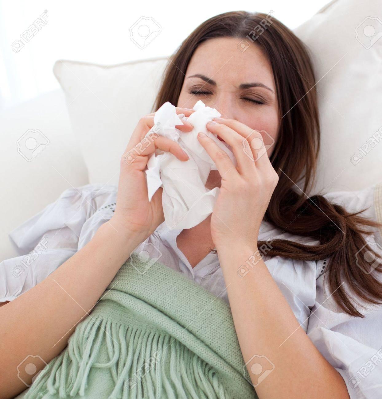 Young sick woman lying on the sofa Stock Photo - 10092087