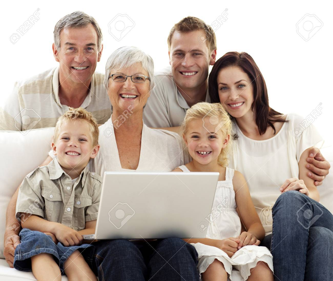 Smiling family using a laptop at home Stock Photo - 10094664