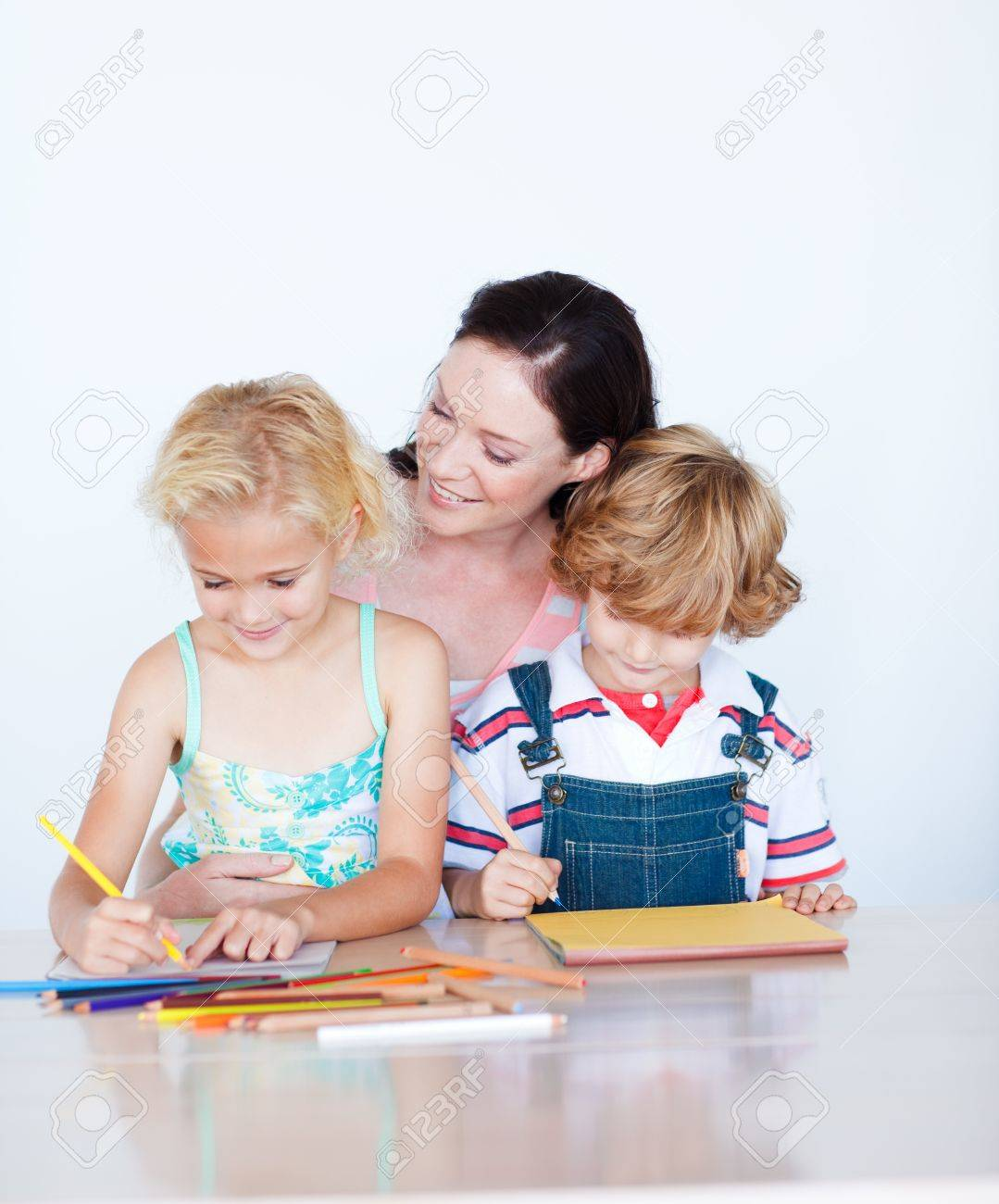 Mother painting with her children Stock Photo - 10113862