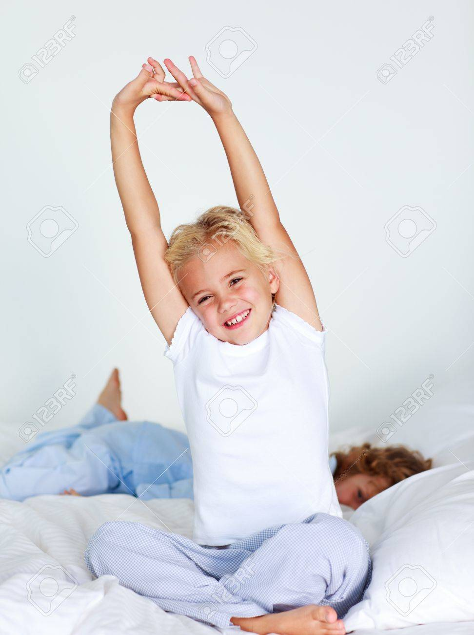 Young child stretching after sleeping Stock Photo - 10113323