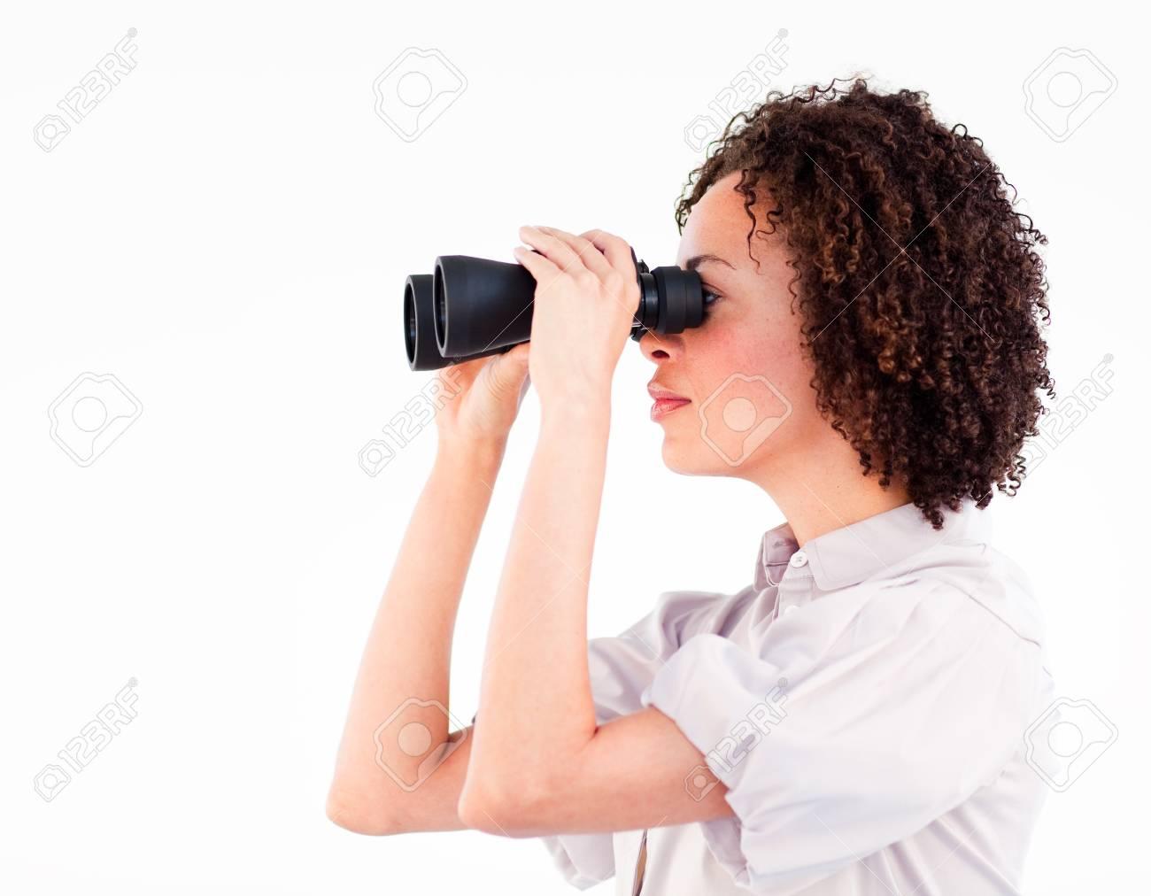 Portrait of attractive businesswoman using binoculars Stock Photo - 10109757
