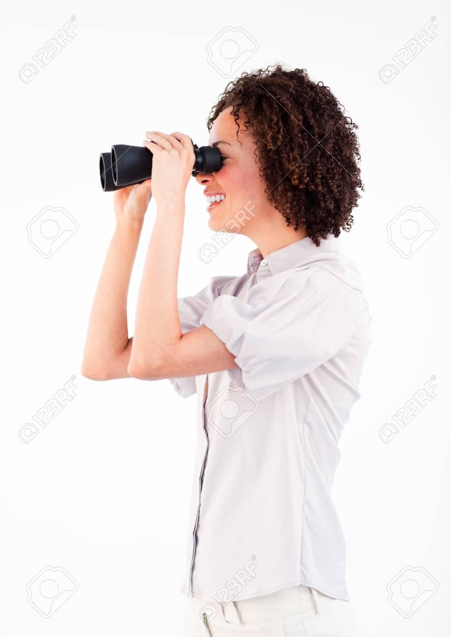 Young businesswoman looking through binoculars Stock Photo - 10110873