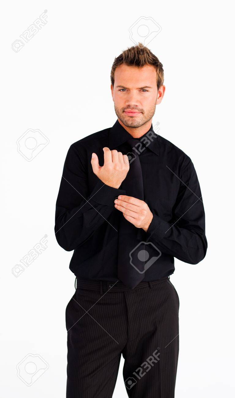 Young businessman corrects a cuff link Stock Photo - 10095947