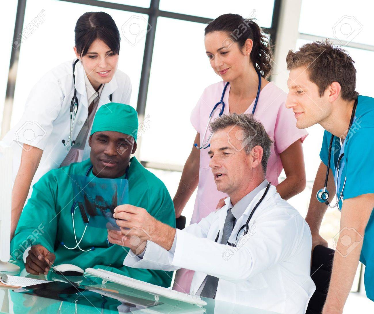 Medical team discussing in an office Stock Photo - 10111205