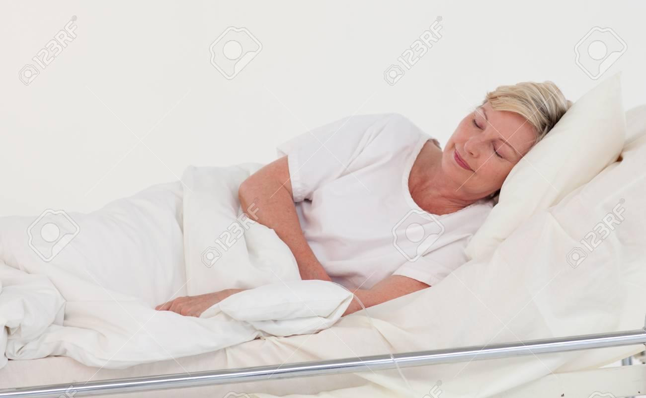 Female patient lying on a medical bed Stock Photo - 10109980