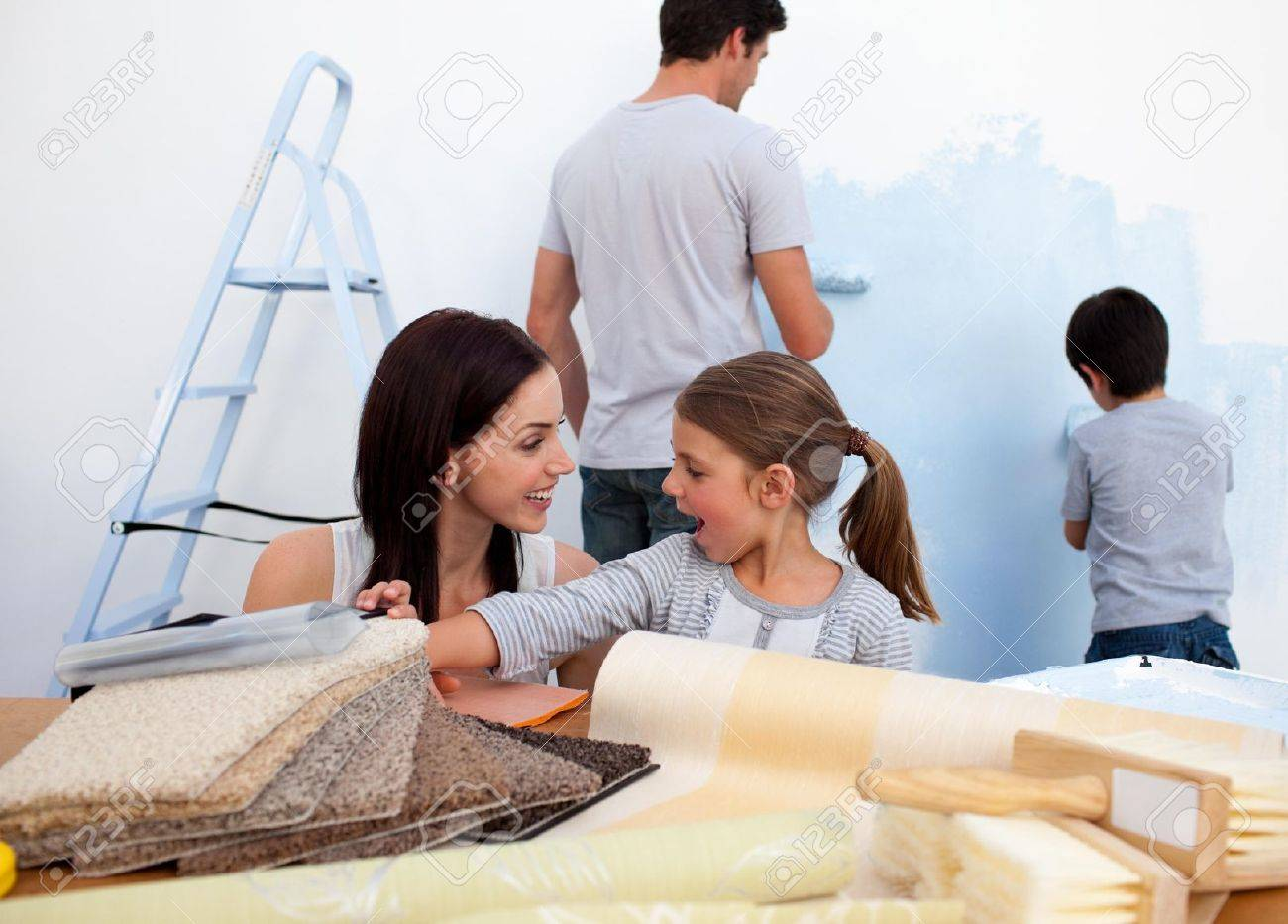 People Decorating Home smiling family decorating their new home stock photo, picture and
