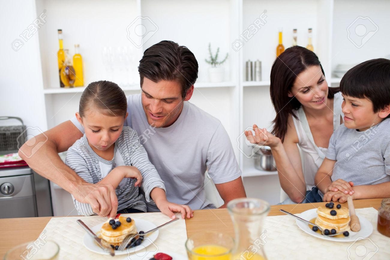 Young family having breakfast together - 10112365
