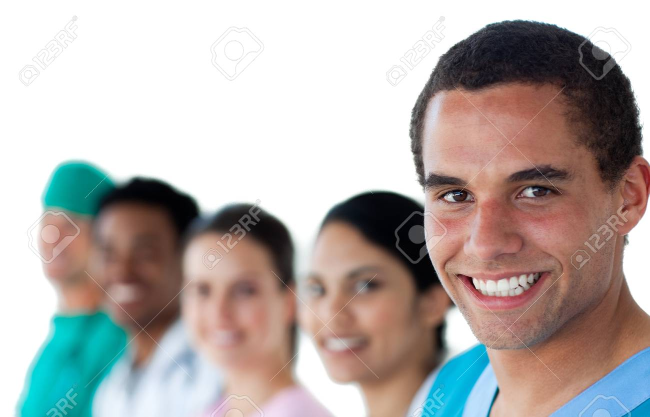 Ethnic young doctor in a row with his team Stock Photo - 10096500