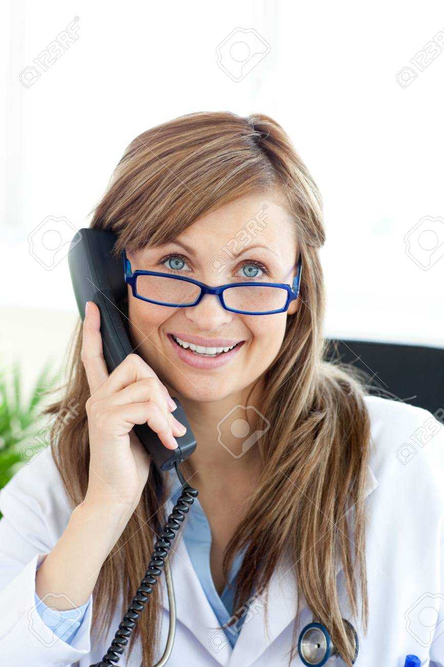 Smiling female doctor talking on the phone Stock Photo - 10113842