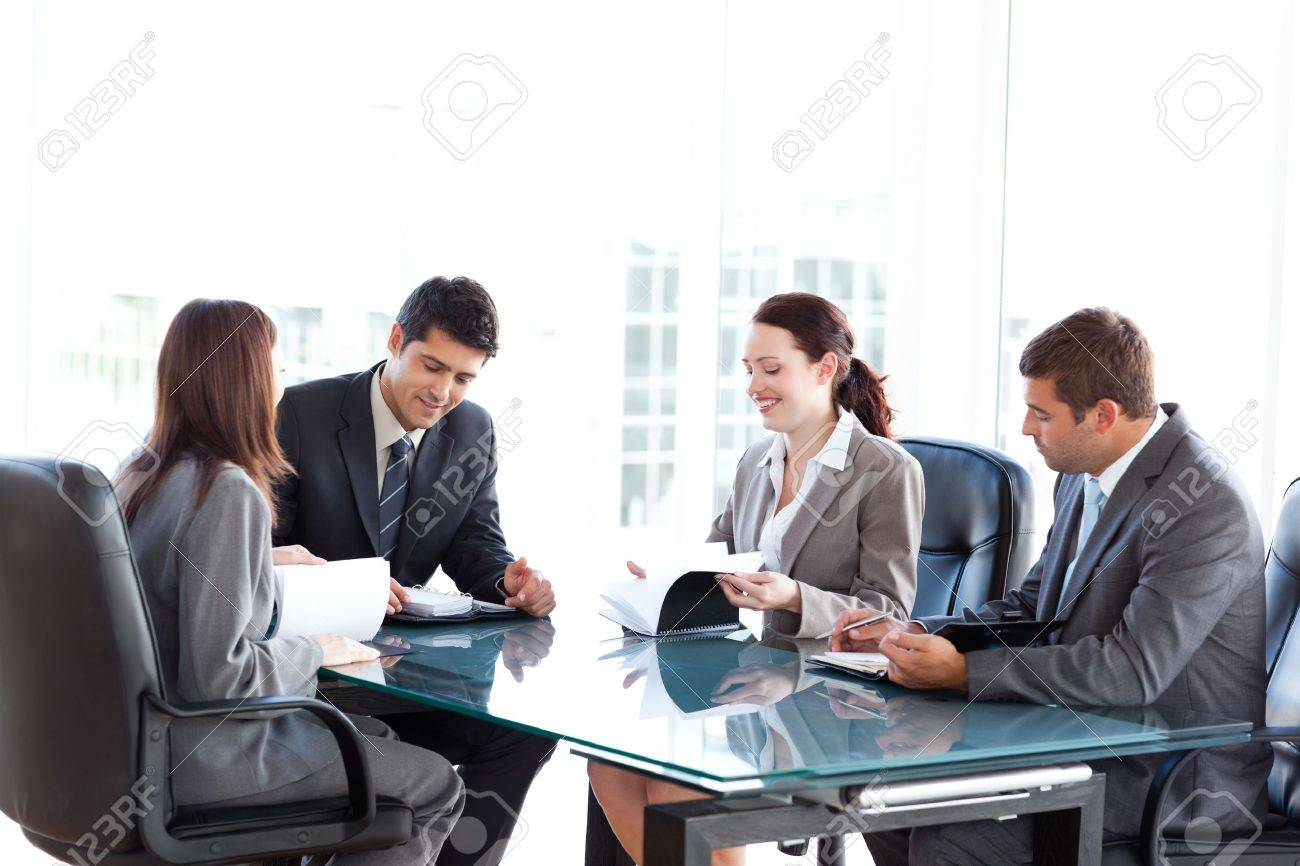 Four business people during a meeting Stock Photo - 10218982