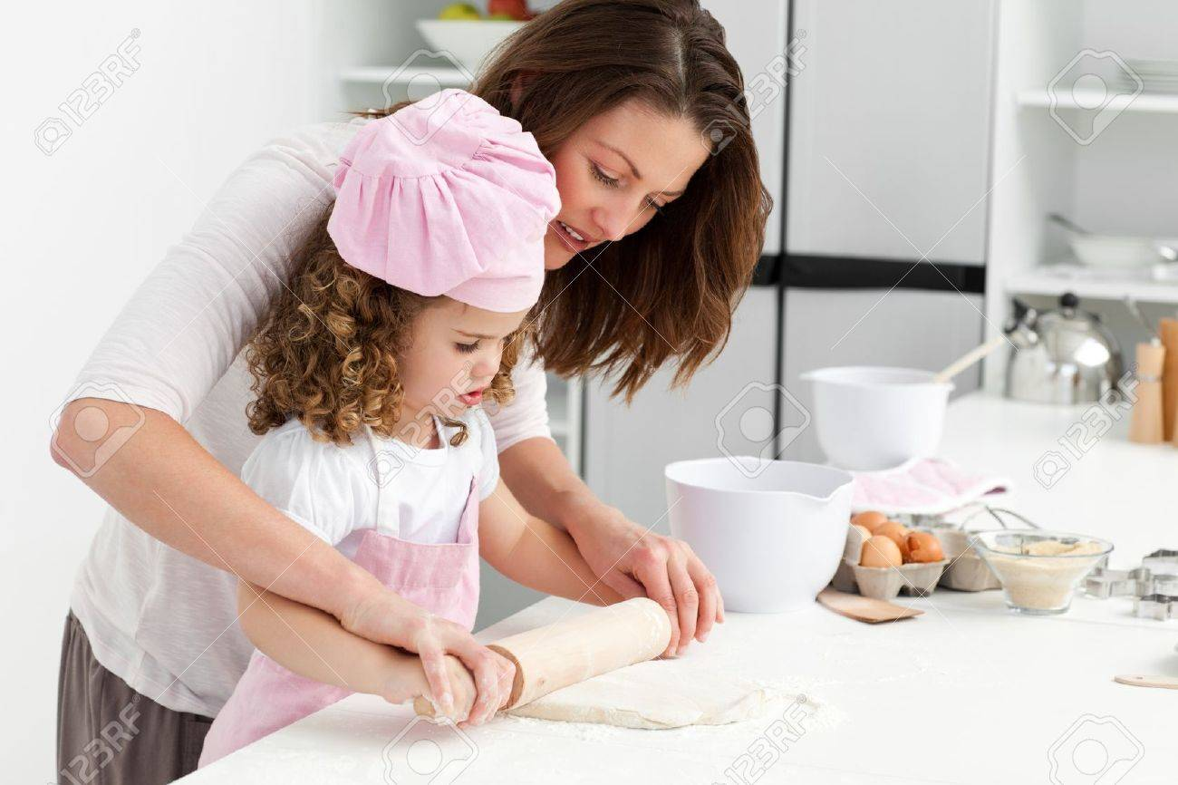 Mother and daughter using a rolling pin together Stock Photo - 10172528