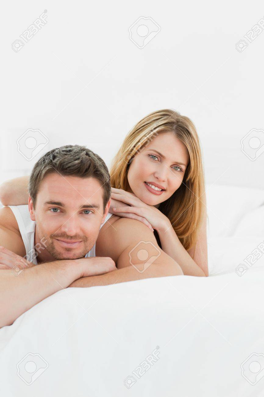 Lovely couple lying down together in their bed at home Stock Photo - 10213924