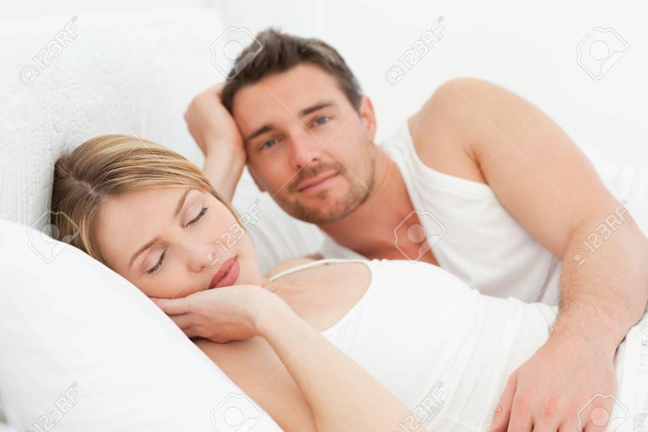 Boyfriend looking at his girlfriend who is  sleeping Stock Photo - 10215165