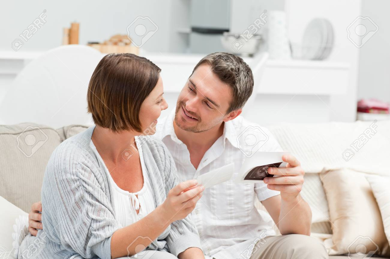 Futur parents looking at X-ray Stock Photo - 10219117