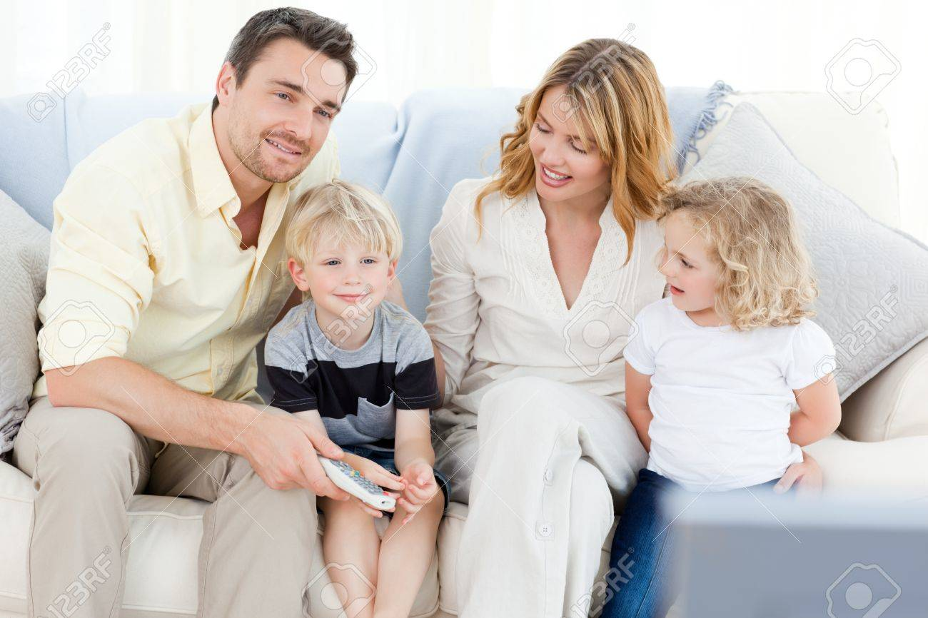 Adorable family watching tv Stock Photo - 10219857