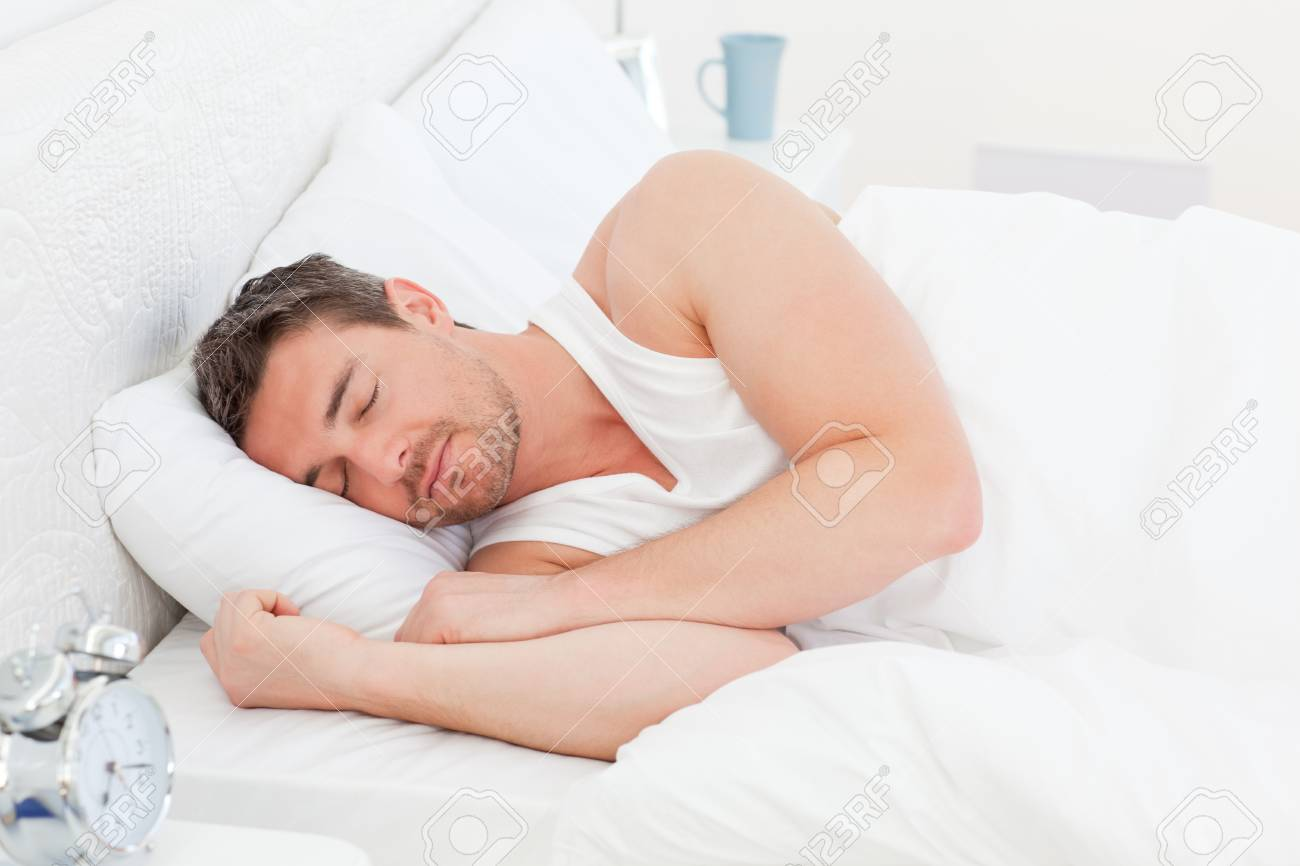 A man in his bed before waking up Stock Photo - 10214306