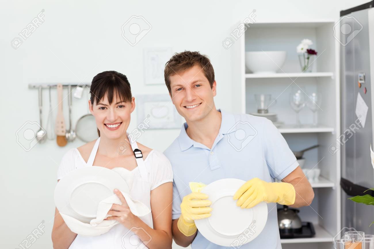 Lovers washing dishes together Stock Photo - 10213890