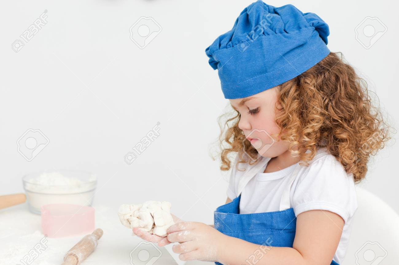 Little girl baking in the kitchen at home Stock Photo - 10220362