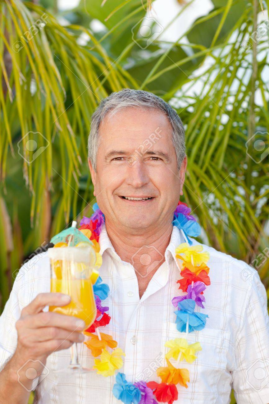 Mature man drinking a cocktail under the sun Stock Photo - 10198092