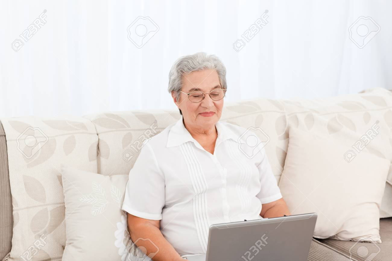 Woman looking at her laptop at home Stock Photo - 10217363