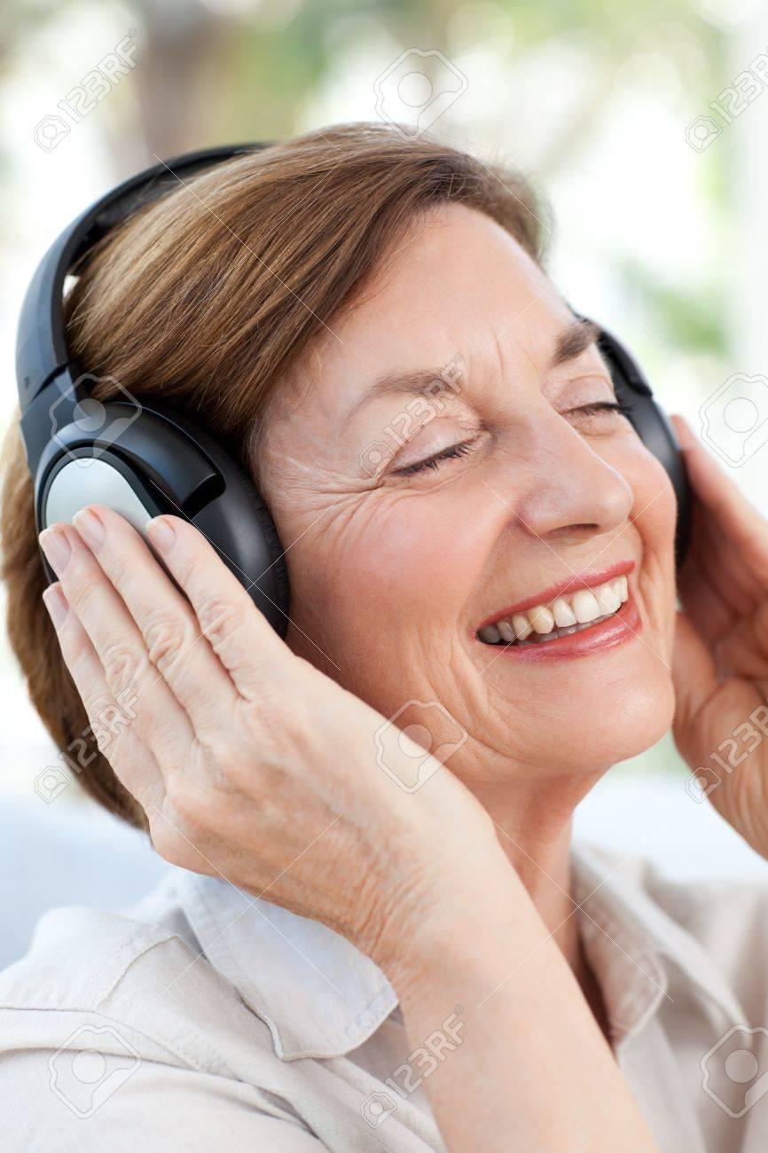 Senior listening to music Stock Photo - 10255497
