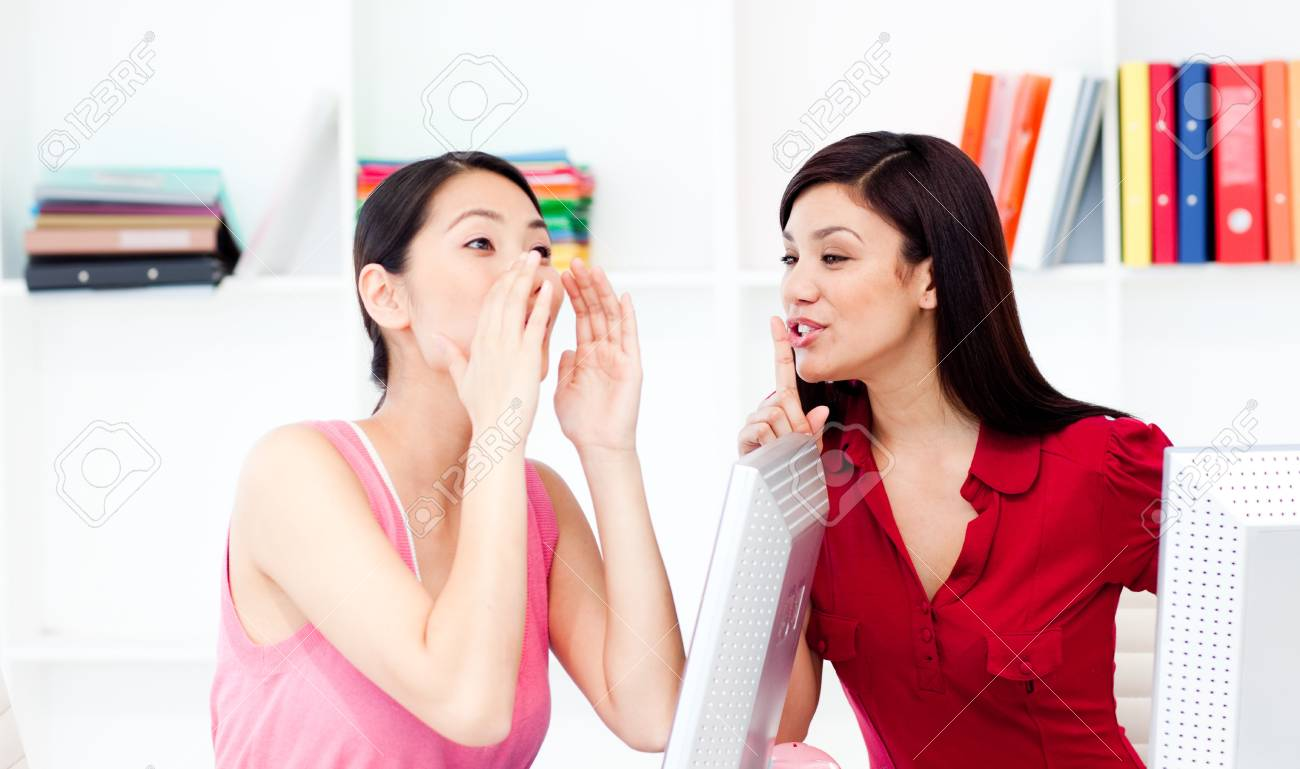 Businesswoman yelling and her colleague asking for silence Stock Photo - 10216101