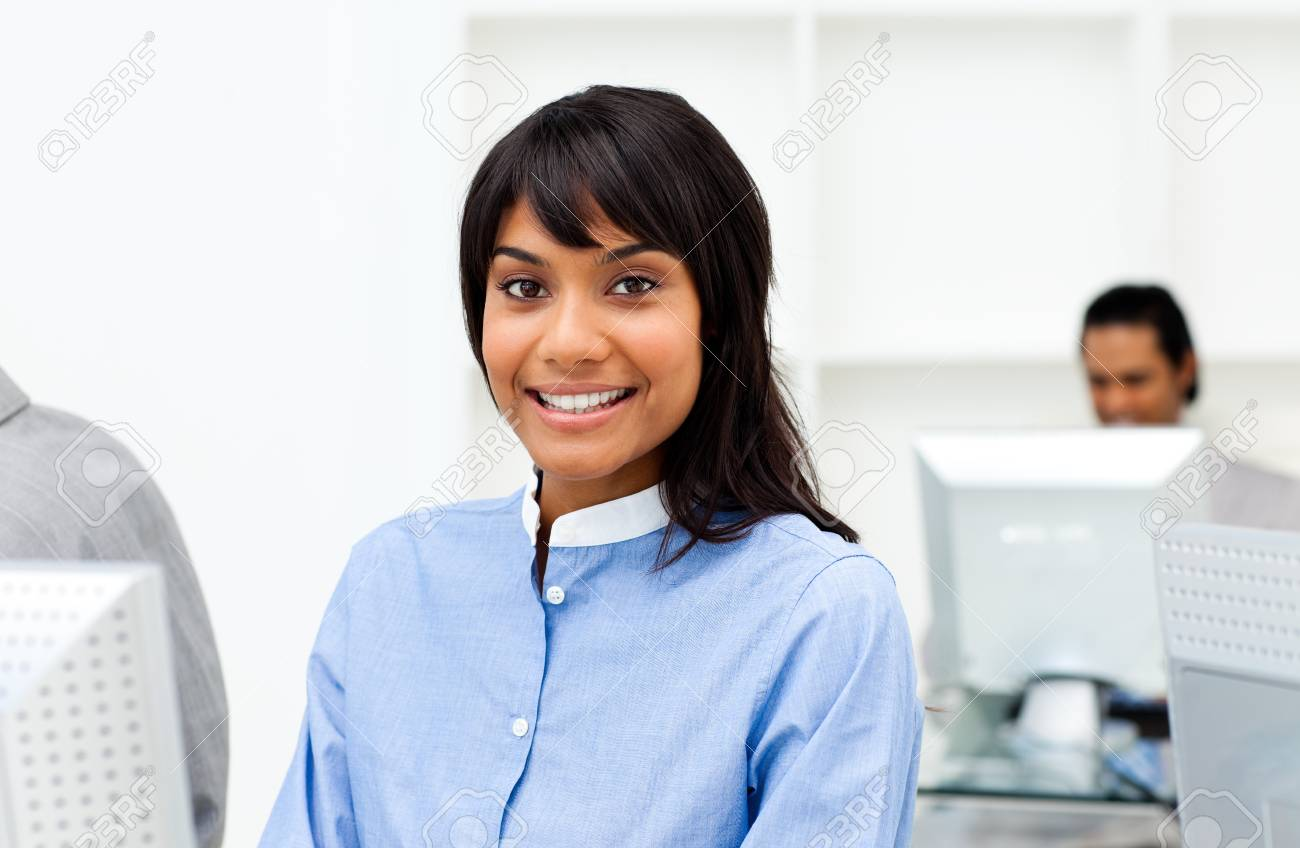 Attractive ethnic businesswoman working at a computer Stock Photo - 10258064